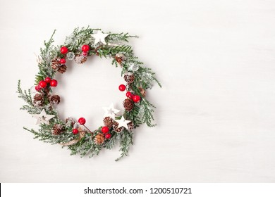 Top view of traditional Christmas wreath with copy space. Winter holidays and Christmas celebration concept