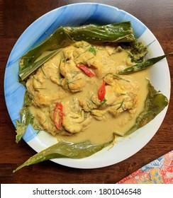 Top View of Traditional Malaysian Dish called Otak Masak Lemak Cili Api dengan Daun Kunyit