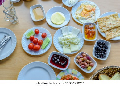 Top view of traditional Turkish breakfast with different food on a wooden table are ready to costumer