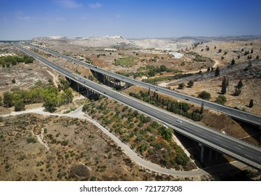Top View of Trans-Israel Highway or Cross-Israel Highway along the green line with part of Judea and Samaria Hills At the Distance