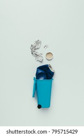 top view of trash bin with assorted garbage isolated on grey, recycling concept