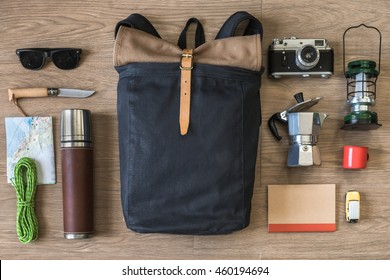 Top View of Travel Stuff on Wood Background, Camping and Coffee, (Backpack, Notebook, Map, Rope, Knife, Coffee Pot and Sunglasses)