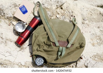 Top view of traveler`s tools for tramp.Concept of adventure, hiking and active lifestyle