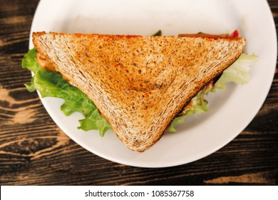 Top view of triangle clubhouse sandwich on plate