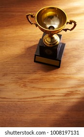 top view of trophy awrd on the wooden background