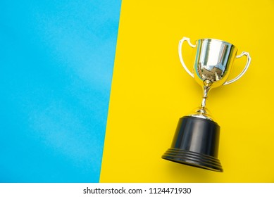 Top view for trophy placed on a colorful background.