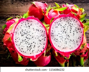 Top view of tropical exotic cut round slices of Dragon fruit Red bark And a small black seeds inside, have a sweet taste.Close-up view Selective focus.