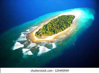top view of tropical island in turquoise blue water. maldives panoramic landscape