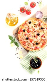Top view of a tuna, olives, onion and basil pizza over a wooden board surrounded by the ingredients