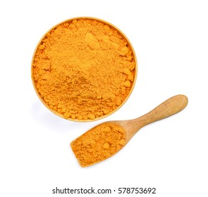 top view of turmeric powder in wooden bowl and spoon isolated on white background