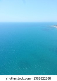 Top view of the turquoise sea and blue sky.