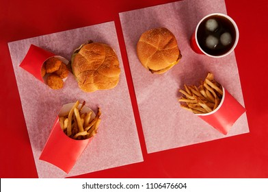 Top view of two wendy´s burgers and fries combos from above