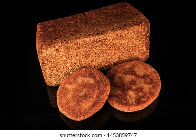 top view of two cereal flapjacks and rectangular rye bread with sesame seeds decoration on black background