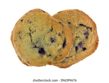 Top view of two freshly baked blueberry muffin tops isolated on a white background.