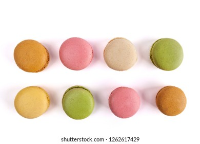 Top view of two rows of French macarons isolated on white