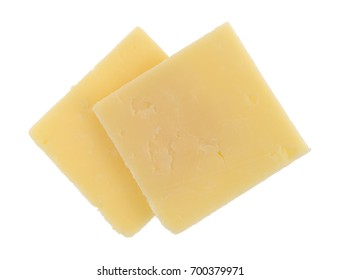 Top view of two slices of a sharp cheddar cheese squares isolated on a white background.