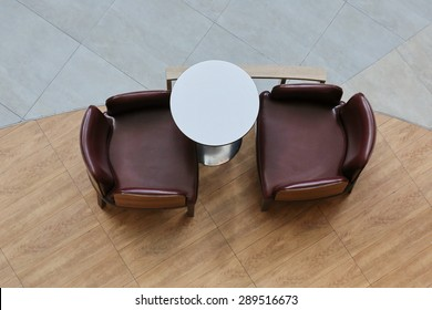 top view two wood chair and table working space on with laptop in beautiful office interior, dinner table background