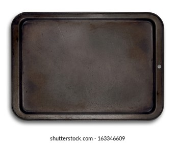 Top view of a used baking tray isolated on white for use in layouts and illustrations