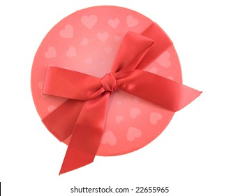 Top view of a Valentines gift box with red bow isolated on white