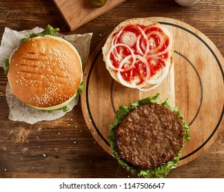 Top view of variety of burgers, served on wooden board
