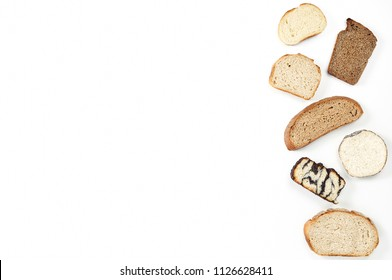Top view of a variety homemade loaves of sliced rye, wheat, whole grain and seeds bread on white background. Bakery flat lay with copy space