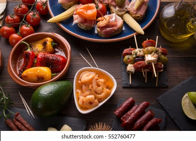 Top view of variety of mediterranean starters - spanish tapas with chorizo, prawns and olives