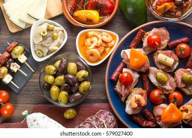 Top view of variety of mediterranean starters - spanish tapas with chorizo and olives