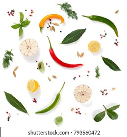 Top view of various herbs and spices ( pepper, basil, cardamom, bay leaf, garlic, lemon, dill and chilli ) isolated on white background.