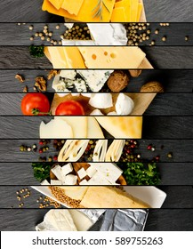 Top view of various kinds of cheese abstract mix with spice and herbs on gray slate surface