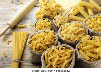 top view Various types of Italian pasta  rustic background