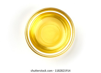 Top view of vegetable or olive oil in a bowl, isolated on white background