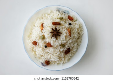 Top view of Vegetable Pulao, Pilaf white rice dish served with nuts rasins Kerala India. Ghee rice, Lemon rice, Basmati.