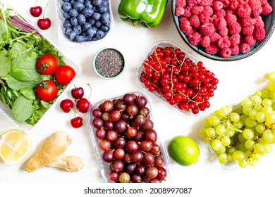 top view of vegetables, fruits, berries, citrus fruits on a white background