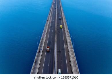 Top view of vehicles crossing on Suramadu bridge connecting island Surabaya and Madura in East Java, Indonesia