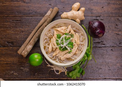 Top view of Vietnamese Chicken noodle soup pho over wooden table