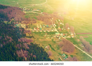 Top view of a village near the forest  in the sunlight