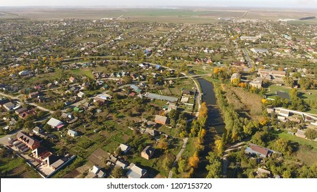 Top view of the village. The village of Poltavskaya. Top view of the village. One can see the roofs of the houses and gardens. Village bird eye view.