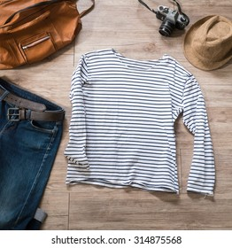 Top view of Vintage clothing and accessories on the wooden background