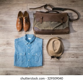 Top view - Vintage male clothing and accessories on the wooden background