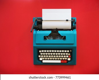 Top view vintage Typewriter on red background,copy space.