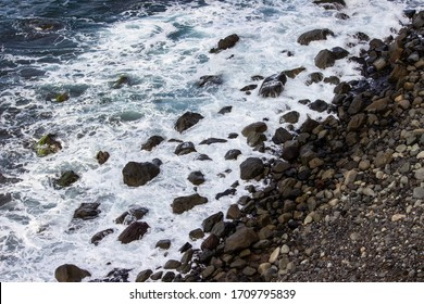 Top view of a volcanic rock beach
