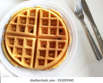Top view of waffle on a white table.