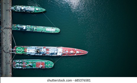 Top view of warships docking in port while parade