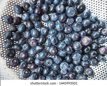 Top view of washed blueberries in colander