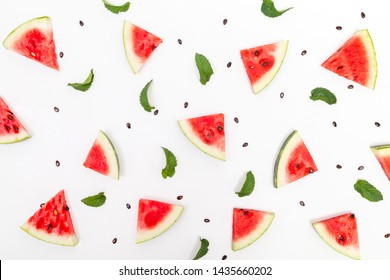 Top view of watermelon pieces, mint leaves and watermelon and melon seeds isolated on white background; fruity wallpaper pattern