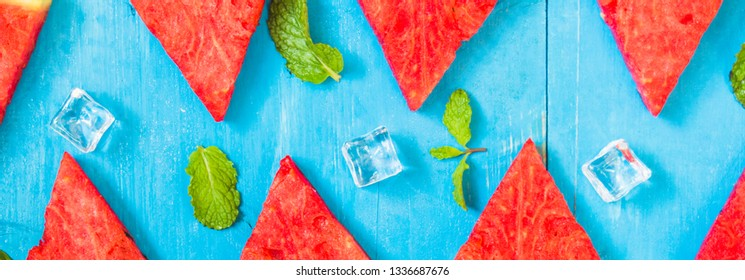 Top view watermelon slices and mint on bright and ice blue wood background,concept organic fruit  non-toxic for health,for refreshing and fun in summer,banner panoramic horizontal