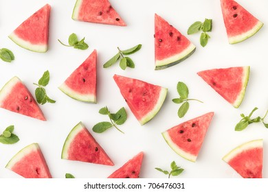 top view of watermelon slices and mint leaves isolated on white background