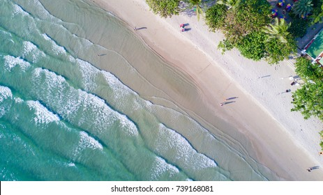Top View of Waves on the Sea. Above the White Sand Beach on Tropical Island. Aerial Top View Scenic Seascape.