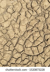 Top view weathered texture and background of arid cracked ground. Broken dried mud from arid problem. Global warming crisis. Agricultural land without water. Climate change