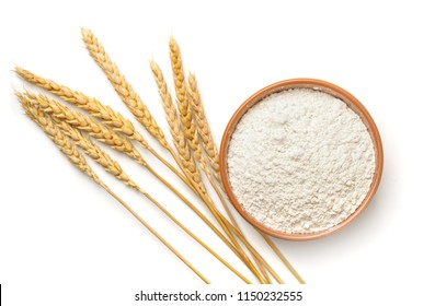 Top view of wheat flour and  ears isolated on white